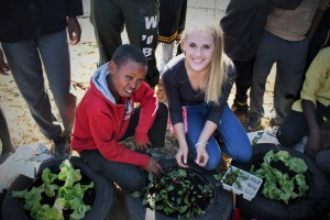 Me working together with one of the pupils planting the seedlings.