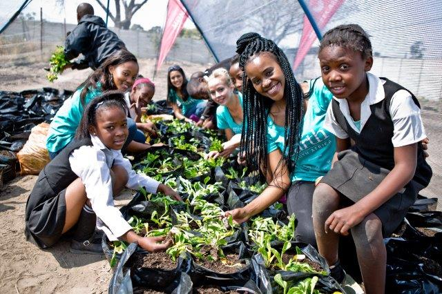 Miss Earth ambassadors set up the vegetable garden for Arbor Day at the Mozomuhle Primary School